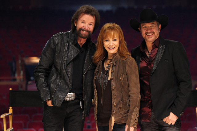 Singer Ronnie Dunn, from left, TV actress Reba McEntire, and singer Kix Brooks, pose for a photo after being announced the newest resident headliners at The Colosseum during a press conference at  ...