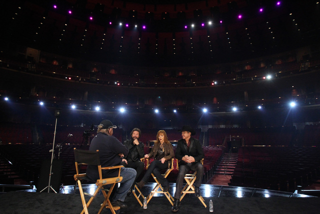 Singer Ronnie Dunn, from left, TV actress Reba McEntire, and singer Kix Brooks, are interviewed after being announced the newest resident headliners at The Colosseum during a press conference at T ...