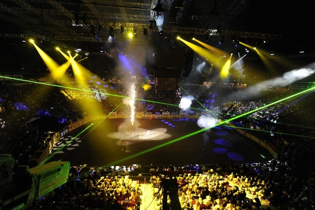Lasers and pyrotechnics are seen prior at the National Finals Rodeo at the Thomas & Mack Center in Las Vegas, Dec. 5, 2014. This year's NFR set an attendance record, drawing 177,565 fans and break ...