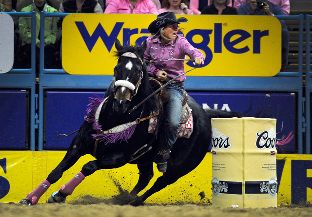 Michele McLeod competes in the barrel racing event during the fifth go-round of the National Finals Rodeo at the Thomas & Mack Center on Monday, Dec. 8, 2014, in Las Vegas.  (David Becker/Las Vega ...