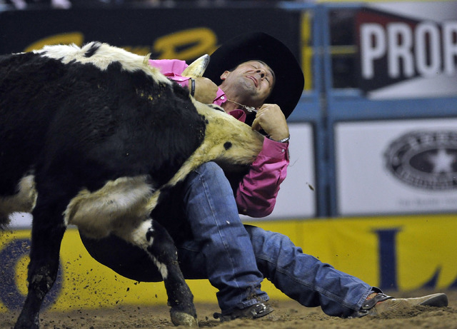 Bray Armes of Ponder, Texas competes in the steer wrestling during the fifth go-round of the National Finals Rodeo at the Thomas & Mack Center on Monday, Dec. 8, 2014, in Las Vegas.  (David Becker ...