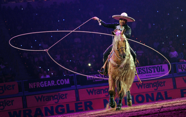 Tomas Garcilazo performs during the opening ceremonies before the start of the fifth go-round of the National Finals Rodeo at the Thomas & Mack Center on Monday, Dec. 8, 2014, in Las Vegas.  (Davi ...