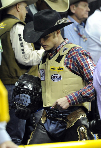 PRCA bull rider Joe Frost is seen on the bucking chute prior to his ride during the eighth go-round of the National Finals Rodeo at the Thomas & Mack Center in Las Vegas, Thursday, Dec. 11, 2014.  ...