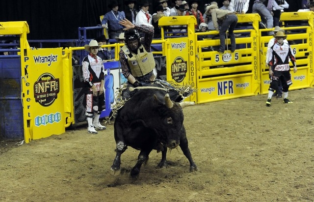 PRCA bull rider Joe Frost rides Powder River Rodeo's Artic Monkey to a score of 78.0 during the eighth go-round of the National Finals Rodeo at the Thomas & Mack Center in Las Vegas, Thursday, Dec ...