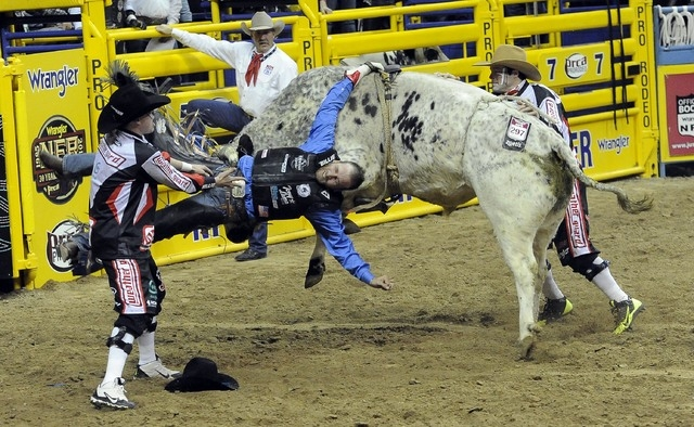 PRCA bull rider J.W. Harris is injured after getting his riding arm stuck in the bull rope and subsequent charging by Sutton Rodeos' Johnny Ringo during the eighth go-round of the National Finals  ...