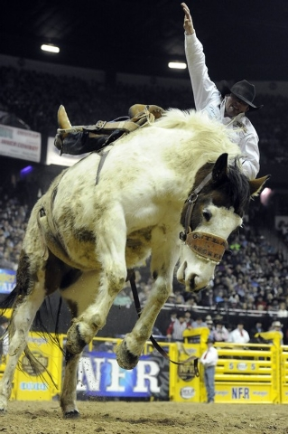 Saddle bronc rider Tyler Corrington from Hastings, Minn., is bucked off his horse during the tenth go-round of the National Finals Rodeo at the Thomas & Mack Center in Las Vegas, Saturday, Dec. 13 ...