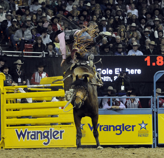 Saddle bronc rider Cole Elshere from Faith, S.D., is bucked off his horse during the tenth go-round of the National Finals Rodeo at the Thomas & Mack Center in Las Vegas, Saturday, Dec. 13, 2014.  ...