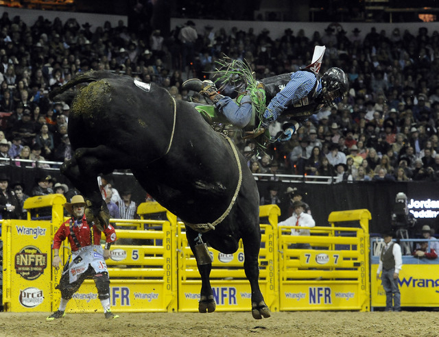 Bull rider Jordan Spears from Redding, Calif., is bucked off his bull during the tenth go-round of the National Finals Rodeo at the Thomas & Mack Center in Las Vegas, Saturday, Dec. 13, 2014. (Jos ...