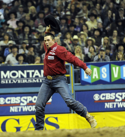 Steer wrestler Dru Melvin from Hebron, Neb., celebrates after earning a first place time of 3.4 seconds during the tenth go-round of the National Finals Rodeo at the Thomas & Mack Center in Las Ve ...