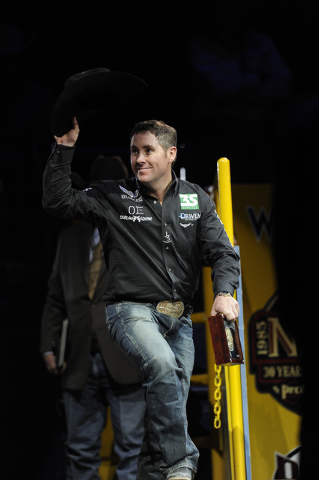 Trevor Brazile from Decatur, Texas, waves to the crowd after winning the all around world championship during the tenth go-round of the National Finals Rodeo at the Thomas & Mack Center in Las Veg ...