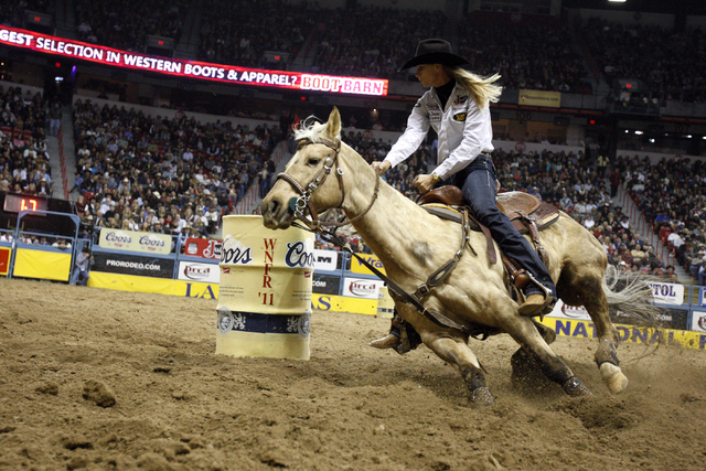 Barrel racer Sherry Cervi, of Marana, Ariz., competes on opening night of the 2011 National Finals Rodeo at the Thomas & Mack Center. Cervi enters this year's NFR as the leading money winner wit ...