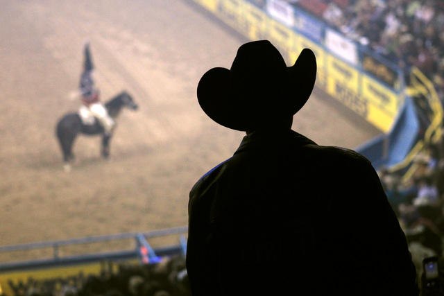 A rodeo fan watches the opening ceremony during the first go around at the National Finals Rodeo Thursday, Dec. 4, 2014 at the Thomas & Mack Center. (Sam Morris/Las Vegas Review-Journal)