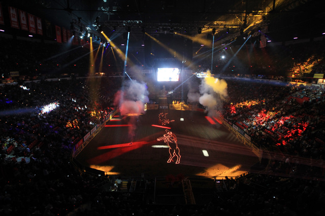 A laser light show kicks off the first go around at the National Finals Rodeo Thursday, Dec. 4, 2014 at the Thomas & Mack Center. (Sam Morris/Las Vegas Review-Journal)