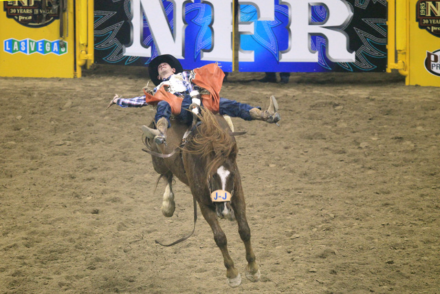 Tim O'Connell from Zwingle, Iowa, rides Pass the Hat during the bareback riding competition at the first go around at the National Finals Rodeo Thursday, Dec. 4, 2014 at the Thomas & Mack Center.  ...