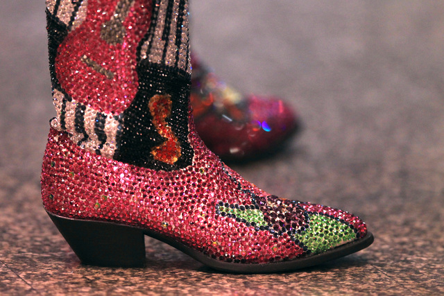 Bejeweled boots are seen during the first go around at the National Finals Rodeo Thursday, Dec. 4, 2014 at the Thomas & Mack Center. (Sam Morris/Las Vegas Review-Journal)