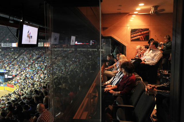 Rodeo fans watch the action from a suite during the first go around at the National Finals Rodeo Thursday, Dec. 4, 2014 at the Thomas & Mack Center. (Sam Morris/Las Vegas Review-Journal)