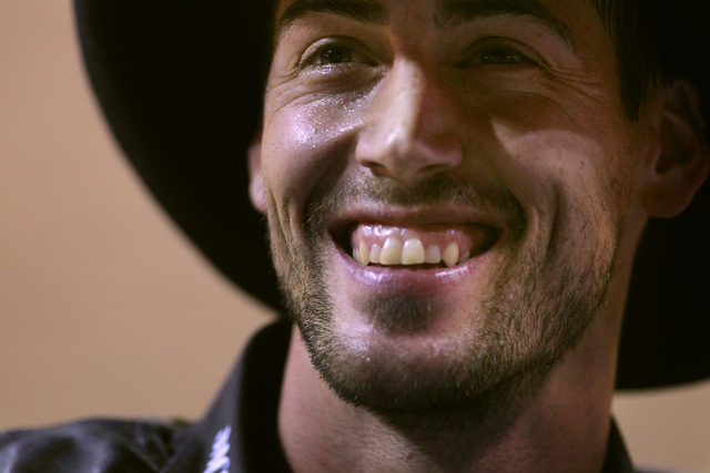 Bull rider Beau Hill from West Glacier, Mont. smiles at someone in the stands during the first go around at the National Finals Rodeo Thursday, Dec. 4, 2014 at the Thomas & Mack Center. (Sam Morri ...