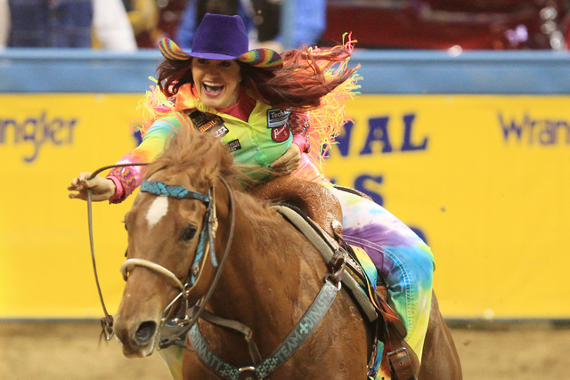 Fallon Taylor from Whitesboro, Texas, rides to a win in the barrel racing competition during the first go around at the National Finals Rodeo Thursday, Dec. 4, 2014 at the Thomas & Mack Center. (S ...