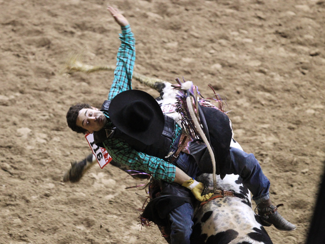 Elliot Jacoby form Fredericksburg, Texas rides Scotland during the bull riding competition at the first go around at the National Finals Rodeo Thursday, Dec. 4, 2014 at the Thomas & Mack Center. ( ...