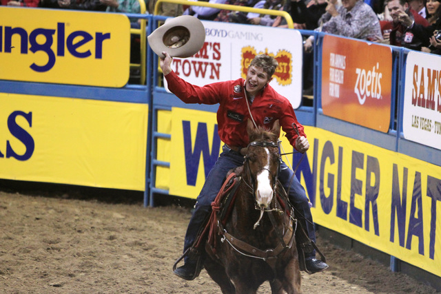 Marty Yates form Stephensville, Texas celebrates his win in the tie-down roping competition at the first go around at the National Finals Rodeo Thursday, Dec. 4, 2014 at the Thomas & Mack Center.  ...
