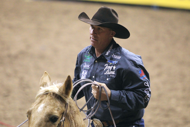 Jake Barnes from Scottsdale, Ariz. competes in the team roping competition during the first go around at the National Finals Rodeo Thursday, Dec. 4, 2014 at the Thomas & Mack Center. (Sam Morris/L ...
