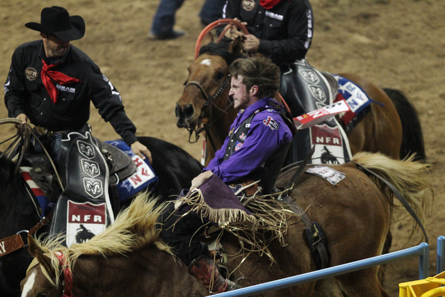 Tilden Hooper competes in bareback riding during the fourth round at the 2014 National Finals Rodeo at the Thomas & Mack Center in Las Vegas, Sunday, Dec. 7, 2014. Hooper finished third with a sco ...