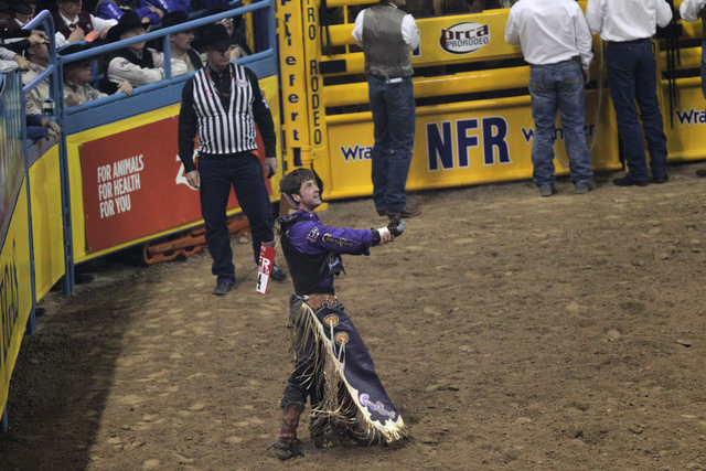 Tilden Hooper looks at his score after competing in bareback riding during the fourth round at the 2014 National Finals Rodeo at the Thomas & Mack Center in Las Vegas, Sunday, Dec. 7, 2014. Hooper ...