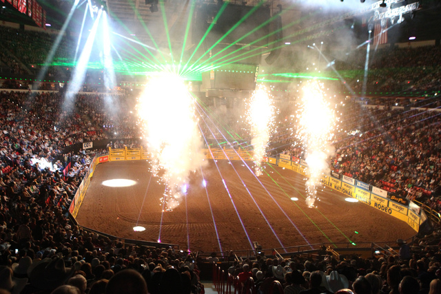 Fireworks explode during the opening of the fourth round at the 2014 National Finals Rodeo at the Thomas & Mack Center in Las Vegas, Sunday, Dec. 7, 2014. Hooper finished third with a score of 83. ...