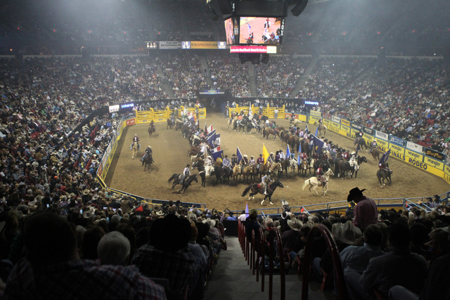 Competitors are welcomed during the opening of the fourth round at the 2014 National Finals Rodeo at the Thomas & Mack Center in Las Vegas, Sunday, Dec. 7, 2014. (Erik Verduzco/Las Vegas Review-Jo ...