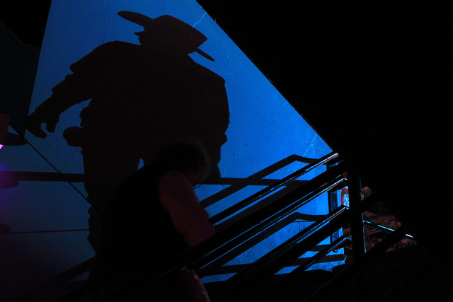 A rodeo fan casts a shadow as he heads to his seat during the sixth go around at the National Finals Rodeo Tuesday, Dec. 9, 2014 at the Thomas & Mack Center. (Sam Morris/Las Vegas Review-Journal)