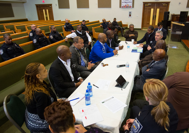 Church leaders and North Las Vegas Police Department representatives gather during a forum to discuss policing in minority communities at Ebenezer Church of God in Christ, located at 1072 W. Bartl ...