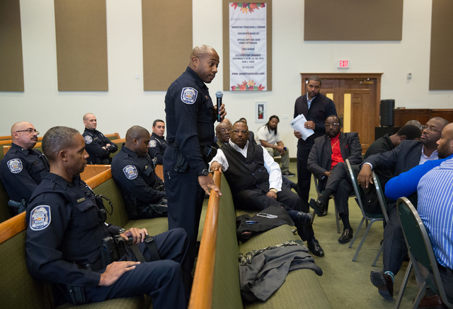 North Las Vegas police officer Michael Harris, center, talks during a forum discussing policing in minority communities at Ebenezer Church of God in Christ, located at 1072 W. Bartlett Ave., Frida ...