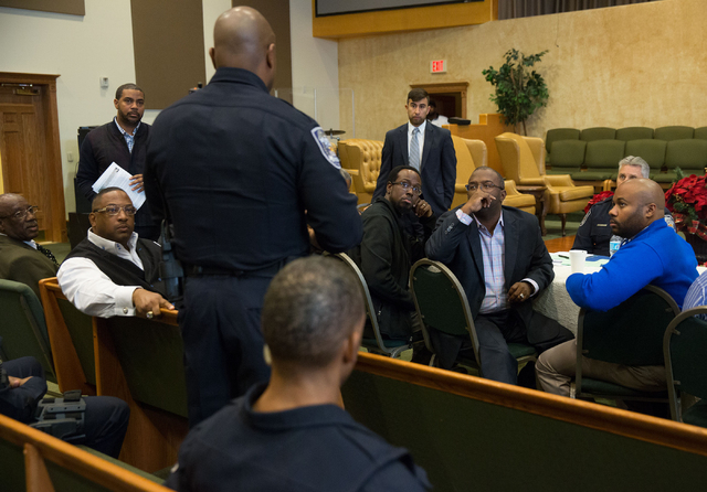 North Las Vegas police officer Michael Harris, fourth from left standing, talks during a forum discussing policing in minority communities at Ebenezer Church of God in Christ, located at 1072 W. B ...