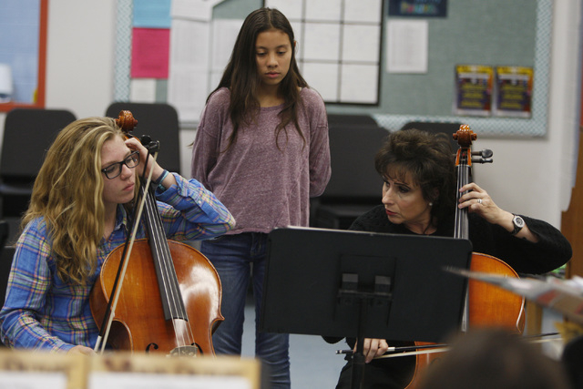 Stephanie Smith demonstrates a cello part to Paige Bushman, left, and Kiana Crane during a chamber orchestra class at Shadow Ridge High School Thursday, Nov. 20, 2014. (Sam Morris/Las Vegas Review ...