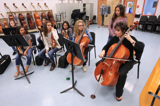 Stephanie Smith demonstrates a cello part during a chamber orchestra class at Shadow Ridge High School Thursday, Nov. 20, 2014. (Sam Morris/Las Vegas Review-Journal)