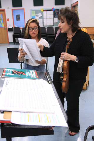 Stephanie Smith helps Gilma Rivera after a chamber orchestra class at Shadow Ridge High School Thursday, Nov. 20, 2014. (Sam Morris/Las Vegas Review-Journal)