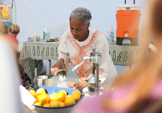Yausmenda Freeman makes organic Myer lemonade at the On the Ranch Farmers and Artisan Market at Craig Ranch Regional Park Sunday, Dec. 7, 2014, in North Las Vegas. The weekly farmers market includ ...