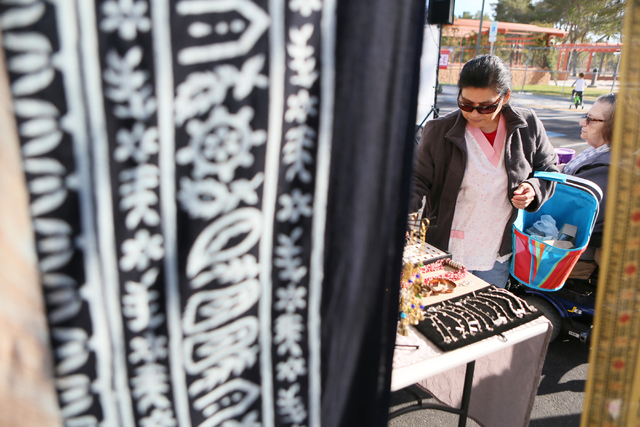 Silvia Gomez shops at the Azian Curio booth at Craig Ranch Regional Park Sunday, Dec. 7, 2014, in North Las Vegas. The weekly farmers market includes fresh produce, artisan goods, music and activi ...