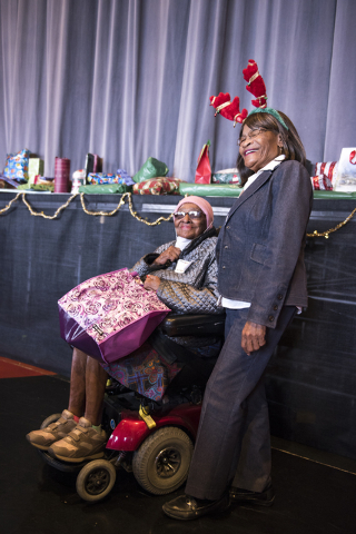 Juanita Radcliff, left, and Dorothy Hale enjoy the annual James Seastrand Helping Hands of North Las Vegas Christmas party for seniors at the Cannery in North Las Vegas on Thursday, Dec. 4, 2014.  ...