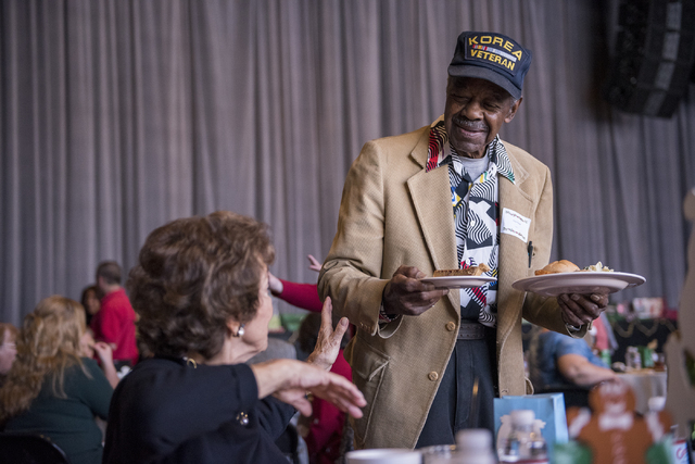 Carmen Hinton, left, speaks to Lloyd Payne during the annual James Seastrand Helping Hands of North Las Vegas Christmas party for seniors at the Cannery in North Las Vegas on Thursday, Dec. 4, 201 ...