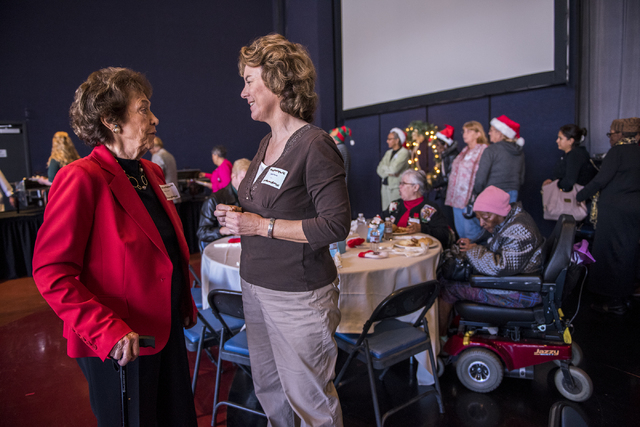 Carmen Hinton, left, speaks to Melody Rapoza during the annual James Seastrand Helping Hands of North Las Vegas Christmas party for seniors at the Cannery in North Las Vegas on Thursday, Dec. 4, 2 ...