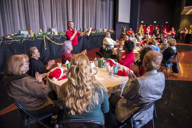 President Joe Dabrowski, top center, of James Seastrand Helping Hands of North Las Vegas, speaks during the organization's annual Christmas party for seniors at the Cannery in North Las Vegas on T ...