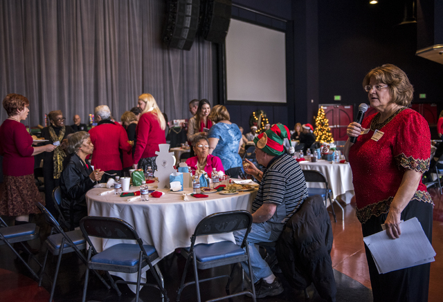 Carolyn Pelletier, right, speaks during the James Seastrand Helping Hands of North Las Vegas annual Christmas party for seniors at the Cannery hotel-casino in North Las Vegas on Thursday, Dec. 4,  ...