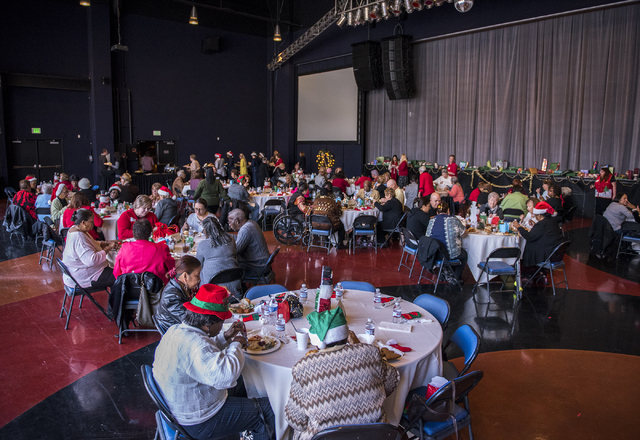 Guests enjoy a Christmas meal during the annual James Seastrand Helping Hands of North Las Vegas Christmas party for seniors at the Cannery in North Las Vegas on Thursday, Dec. 4, 2014. (Martin S. ...