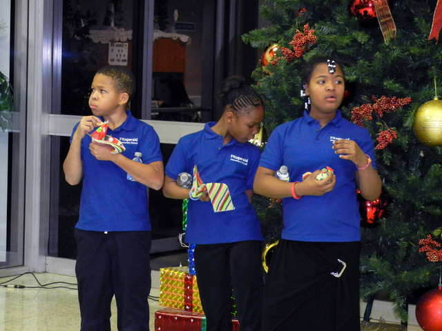 Members of the Fitzgerald Elementary School Choir chow down on holiday treats during the North Las Vegas Christmas tree lighting ceremony at City Hall on Wednesday, Dec. 1, 2010. Clad in blue polo ...