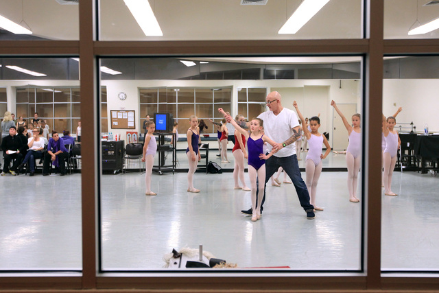 Artistic director James Canfield helps a dancer get in position during rehearsals for the Nevada Ballet Theater's 2014 production of The Nutcracker Wednesday, Dec. 3, 2014. (Sam Morris/Las Vegas R ...