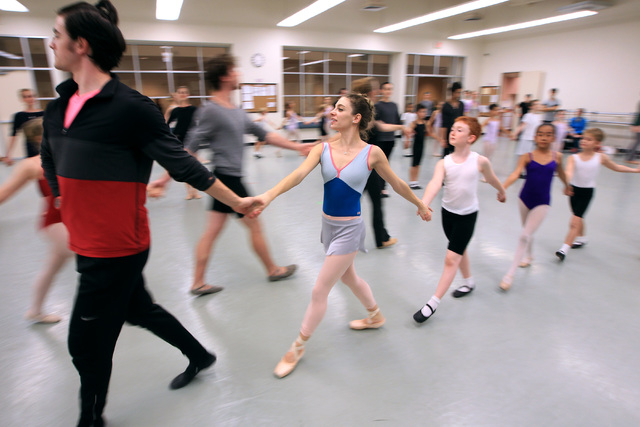 Betsy Lucas, center, in the roll of Clara, rehearses for the Nevada Ballet Theater's 2014 production of The Nutcracker Wednesday, Dec. 3, 2014. (Sam Morris/Las Vegas Review-Journal)