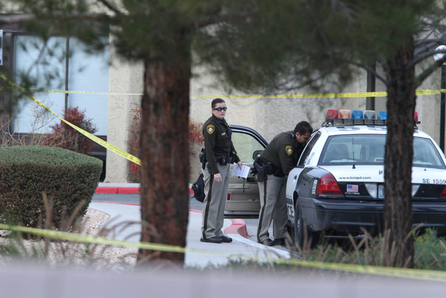 Las Vegas police investigates the scene of a reported shooting at the intersection of Tompkins Avenue and Tiburon South Avenue in Las Vegas Sunday, Dec. 21, 2014. (Erik Verduzco/Las Vegas Review-J ...