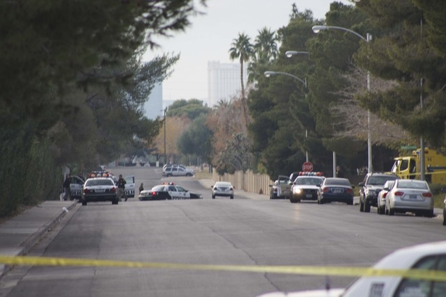 Police activity in a neighborhood near South Mojave Road and East Harmon Avenue on Sunday closed roads. Reports indicated that a Metro officer was involved in a shooting. (Kristen DeSilva/Las Vega ...