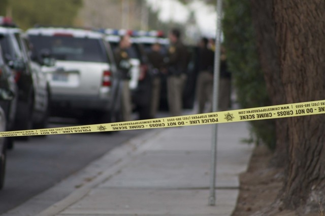 Police tape blocks access to the scene of an officer-involved shooting on Sunday near South Mojave Road and East Harmon Avenue. (Kristen DeSilva/Las Vegas Review-Journal)
